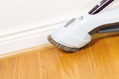 Cleaning Floor and Trim work with Vacuum Cleaner royalty free stock images