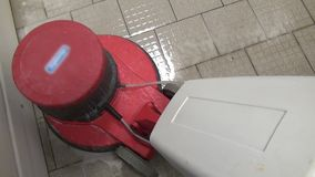 Cleaning of floors with red washing vacuum cleaner in factory. Sanitary treatment of industrial equipment. Chemical detergents stock video