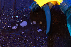 Cleaning fluid. Spray bottle yellow and blue Royalty Free Stock Image