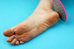 Cleaning foot feet with a saw or brush. Cleaning the feet of the fungus. Cleaning the feet of the fungus. Cleaning foot feet with a saw or brush royalty free stock image