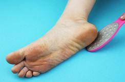 Cleaning foot feet with a saw or brush. Cleaning the feet of the fungus. Cleaning the feet of the fungus. Cleaning foot feet with a saw or brush royalty free stock photography