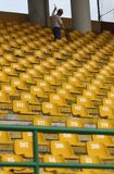Cleaning football stadium Stock Photo