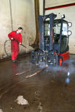 Cleaning a forklift Royalty Free Stock Photography