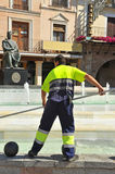 Cleaning a fountain, municipal service worker Royalty Free Stock Photos