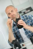 Cleaning fragile camera lens Stock Photos