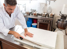 Cleaning of French sweet nougat specialty by pastry craftsman Stock Images