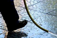 Cleaning the fresh set pavement block Royalty Free Stock Photos