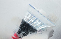 Cleaning frozen car windows Royalty Free Stock Image