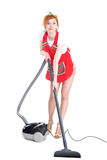 Cleaning is fun. Sexy young housewife cleaning the carpet. With vacuum cleaner Royalty Free Stock Image