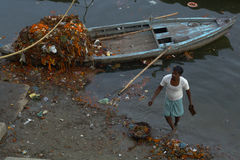 Cleaning The Ganges. Hindu man cleans up the Ganges River at Varanasi, India Stock Images