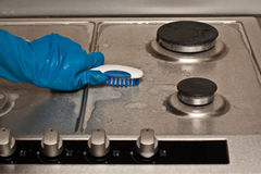 Cleaning a gas stove Royalty Free Stock Image