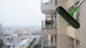 Cleaning glass window. In an apartment stock video footage