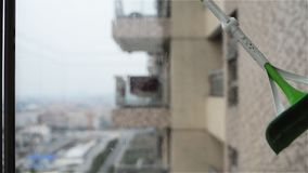 Cleaning glass window. In an apartment stock footage