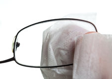Cleaning glasses with cloth Stock Photography