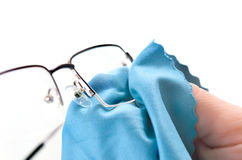 Cleaning glasses Royalty Free Stock Images