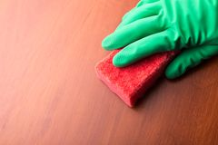 Cleaning glove with a sponge. Closeup Royalty Free Stock Image