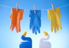Cleaning gloves and detergents Royalty Free Stock Image