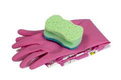 Cleaning Gloves With Sponge. Pink gloves with scrubbing sponge ready to use for cleaning.   with shadows Royalty Free Stock Photos
