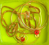 Cleaning gold ornaments. A process of cleaning gold ornaments stock photo