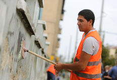 Cleaning graffiti Stock Photography
