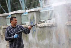 Cleaning graffiti Stock Photo