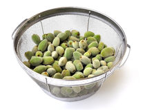 Cleaning green almonds Royalty Free Stock Images