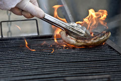 Cleaning grill Stock Photo