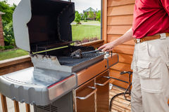 Cleaning grill Stock Images