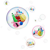 Cleaning and grooming. Variety of cleaning products and toiletries inside bubbles Royalty Free Stock Photography