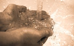 Cleaning hands. Picture of female adult cleaning both hands Stock Images
