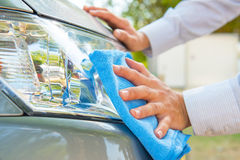 Cleaning headlight Royalty Free Stock Photo