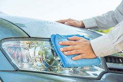 Cleaning headlight Stock Image