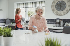 Cleaning With Help From My Daughter Royalty Free Stock Image
