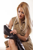 Cleaning her boots stock images