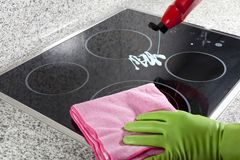 Cleaning the hob Stock Images