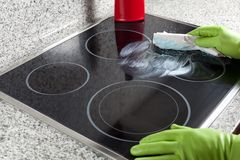 Cleaning the hob Royalty Free Stock Image