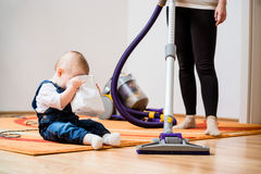 Cleaning home - mother and child Stock Images