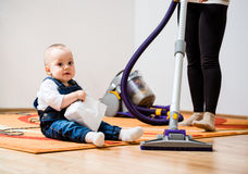 Cleaning home - mother and child Royalty Free Stock Photo