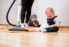Cleaning home - mother and child Stock Photo