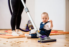 Cleaning home - mother and child Stock Photography