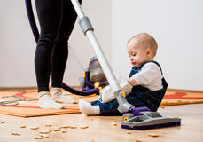 Cleaning home - mother and child Royalty Free Stock Photos