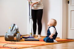 Cleaning Home - Mother With Baby Stock Photo