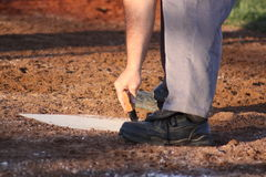 Cleaning home plate Stock Photos