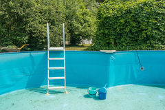 Cleaning the home pool. At the beginning of the summer season Stock Image