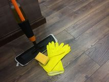 Cleaning the house, cleaning services. The background of the wooden field stock photo