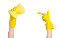 Cleaning the house and sanitation topic: Hand holding a yellow sponge wet with foam isolated on a white background in studio Stock Images