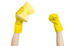 Cleaning the house and sanitation topic: Hand holding a yellow sponge wet with foam isolated on a white background in studio stock image