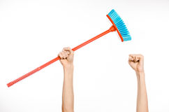 Cleaning the house topic: human hand holding a red broom Stock Photography