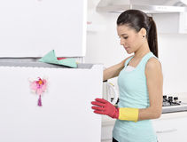 Cleaning the house. Women cleaning the fridge. woman worker Royalty Free Stock Photo