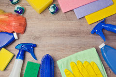 Cleaning and household concept with supplies on wooden background. View from above Stock Photos